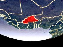Burkina Faso at night from space. Satellite view of Burkina Faso from space at night. Beautifully detailed plastic planet surface with visible city lights. 3D royalty free stock image
