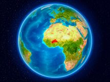 Burkina Faso on Earth. Burkina Faso in red from Earth's orbit. 3D illustration. Elements of this image furnished by NASA Royalty Free Stock Images