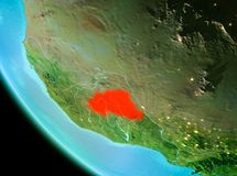 Burkina Faso in red in the evening. Country of Burkina Faso in red on planet Earth in the evening. 3D illustration. Elements of this image furnished by NASA Royalty Free Stock Image