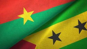 Burkina Faso and Sao Tome and Principe two flags textile cloth, fabric texture. Burkina Faso and Sao Tome and Principe two folded flags together stock illustration