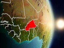 Burkina Faso during sunrise. Highlighted in red on planet Earth with visible country borders. 3D illustration. Elements of this image furnished by NASA Stock Image