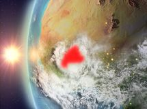 Burkina Faso tijdens zonsondergang van ruimte Stock Fotografie