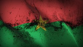Burkina Faso grunge dirty flag waving on wind. Burkinabe background fullscreen grease flag blowing on wind. Realistic filth fabric texture on windy day Stock Photography