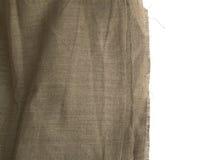 Burlap άκρη ή παλαιός καμβάς λινού στο άσπρο υπόβαθρο Στοκ Εικόνα