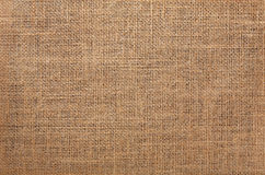 Burlap. Brown burlap fabric background texture stock images