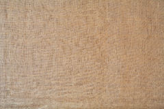 Burlap. Old stained and worn burlap background texture stock image