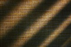Burlap abstract background brown texture. Light and shadow. royalty free stock images