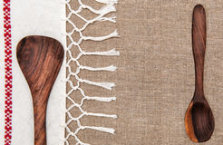 Burlap background bordered by country cloth and utensils Stock Photo