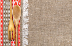 Burlap background bordered by country cloth and utensils Royalty Free Stock Image