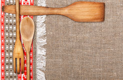 Burlap background bordered by country cloth and utensils Royalty Free Stock Photography