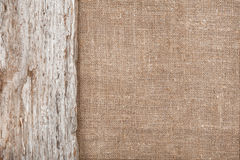 Burlap background bordered by old wood Royalty Free Stock Images