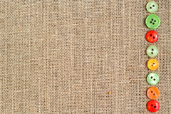 Burlap background with buttons border Stock Photography