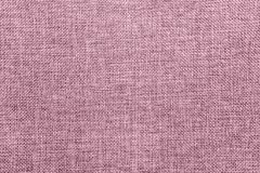 Burlap background colored in pale pink blend. Empty abstract background with natural burlap detailed texture. Ecology friendly rough fabric threads colored in royalty free stock images