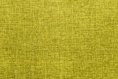 Burlap background colored in yellow green blend royalty free stock photo