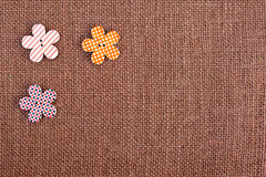 Burlap background - flower shape buttons Stock Photos