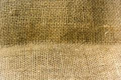 Burlap background. Grunge close-up framed burlap background Stock Photography
