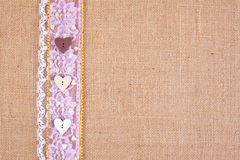 Burlap background - with lace and button border. Background - natural color burlap hessian with lace and button border stock photography