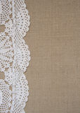 Burlap background with lace. Burlap background with crochet lace Stock Photo