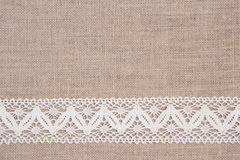 Burlap background with lace Royalty Free Stock Photos