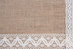 Burlap background with lace Stock Photos