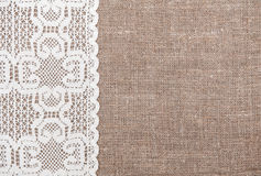Burlap background with lacy cloth. Burlap background and white lacy cloth stock photos