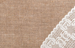 Burlap background with lacy cloth Stock Photography