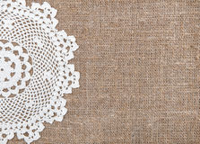 Burlap background with lacy cloth. Burlap background and white lacy cloth stock photo