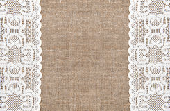 Burlap background with lacy cloth. Burlap background and white lacy cloth stock images