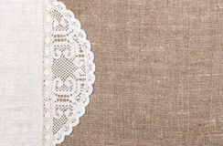 Burlap background with lacy and linen cloth. Burlap background with white lacy and linen cloth Royalty Free Stock Photo