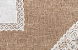 Burlap background with lacy and linen cloth Royalty Free Stock Photos