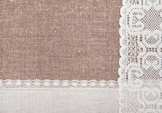 Burlap background with lacy and linen cloth Stock Images