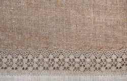 Burlap background with lacy and linen cloth Royalty Free Stock Photography