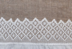 Burlap background with lacy and linen cloth Royalty Free Stock Images