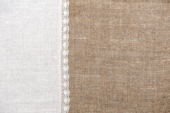 Burlap background with linen cloth. Burlap background and linen cloth with lace Stock Image