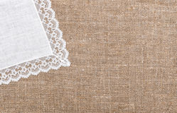 Burlap background with linen cloth. Burlap background and linen cloth with lace Stock Photo