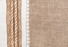 Burlap background with linen cloth and rope. Burlap background, rope and linen cloth with lace Royalty Free Stock Images