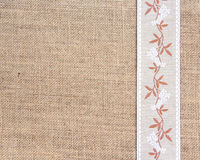 Burlap background with ribbon Stock Image