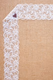 Burlap background - white lace. Background - natural color burlap hessian with white lace border royalty free stock images