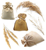 Burlap bags with herbs. Set of isolated burlap bags and herbs isolated stock photography