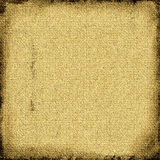 Burlap canvas grunge. Golden brown textured canvas of burlap grungy style Royalty Free Stock Photos