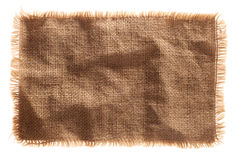 Burlap canvas isolated with lacerate edge. Very detailed hi res photo of a burlap canvas isolated with lacerate edge, for backgrounds, textures and layers Stock Images