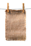 Burlap canvas with lacerate edges hanging Royalty Free Stock Image