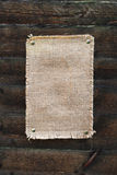 Burlap canvas with lacerate edges on old grunge Royalty Free Stock Photos