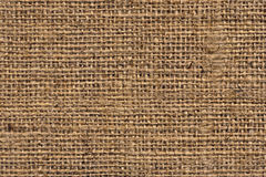 Burlap Canvas Natural Brown Loosely Woven Rough Grunge Texture. Burlap canvas, natural Brown, loosely woven, rough grunge surface texture Royalty Free Stock Images