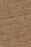 Burlap Canvas Natural Brown Loosely Woven Rough Grunge Texture. Burlap canvas, natural Brown, loosely woven, rough grunge surface texture Royalty Free Stock Photography