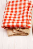 Burlap and cloth in the box on a white table Royalty Free Stock Images