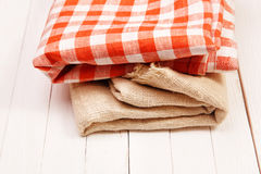 Burlap and cloth in the box on a white table. Burlap and cloth in the box on a white wooden table Stock Photos