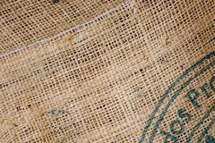 Burlap coffee sack. Closeup of brown burlap coffee sack royalty free stock photography