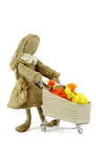 Burlap doll with shopping cart Stock Photo
