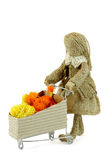 Burlap doll with shopping cart Royalty Free Stock Images